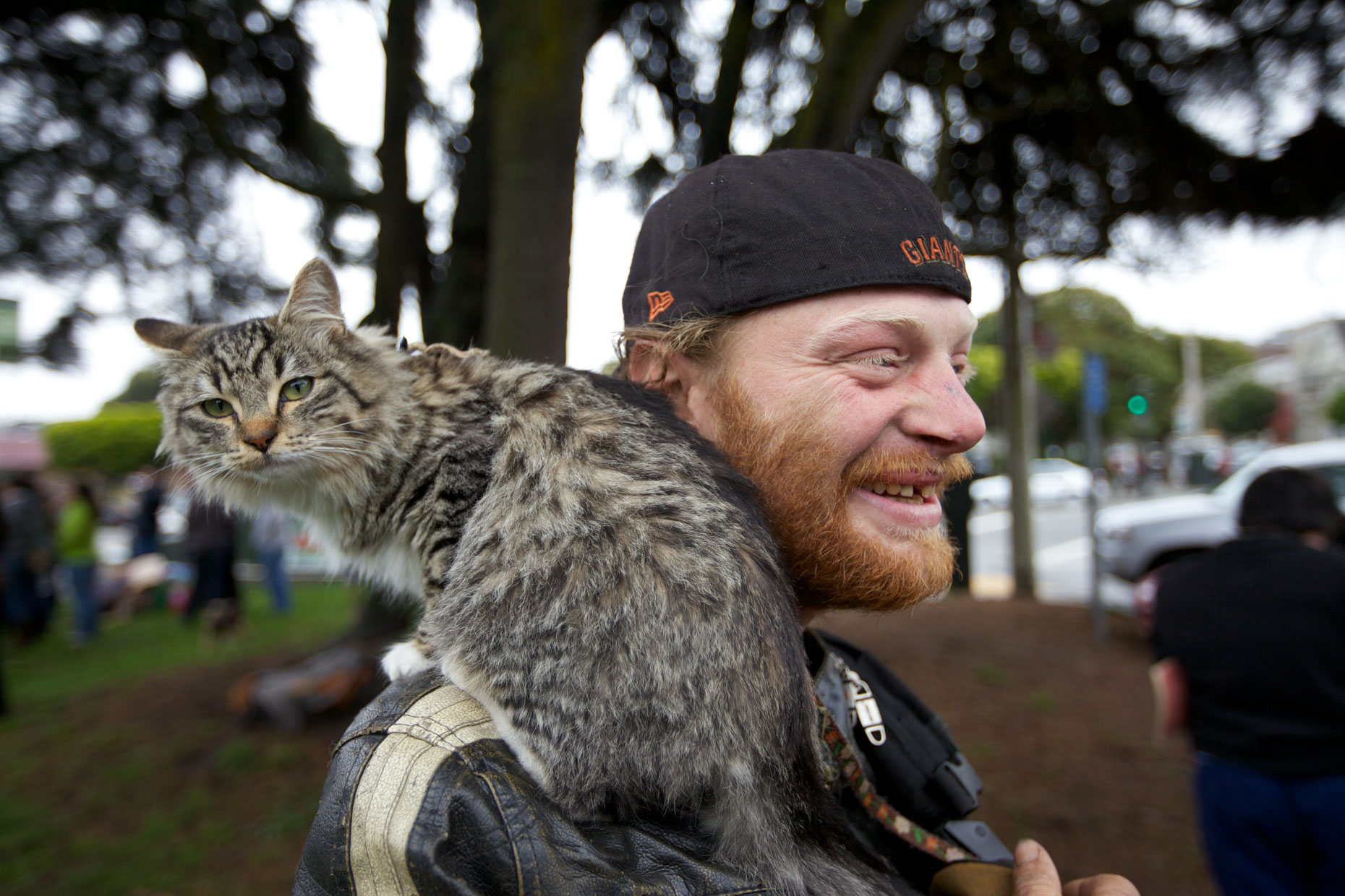 Editorial Photography | Man with Cat on Shoulder by Mark Rogers