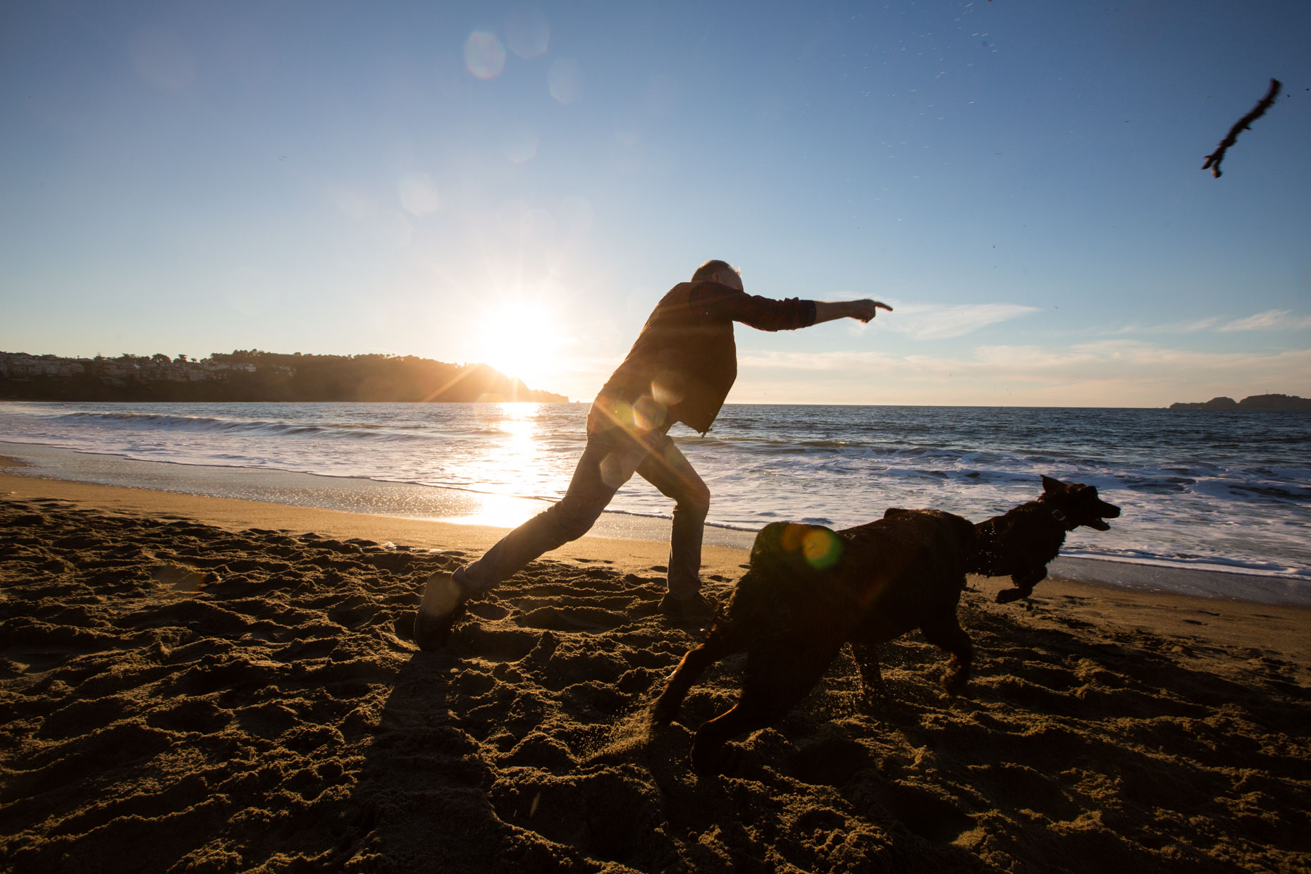 Lifestyle Photography: Man Playing with Dogs by Mark Rogers