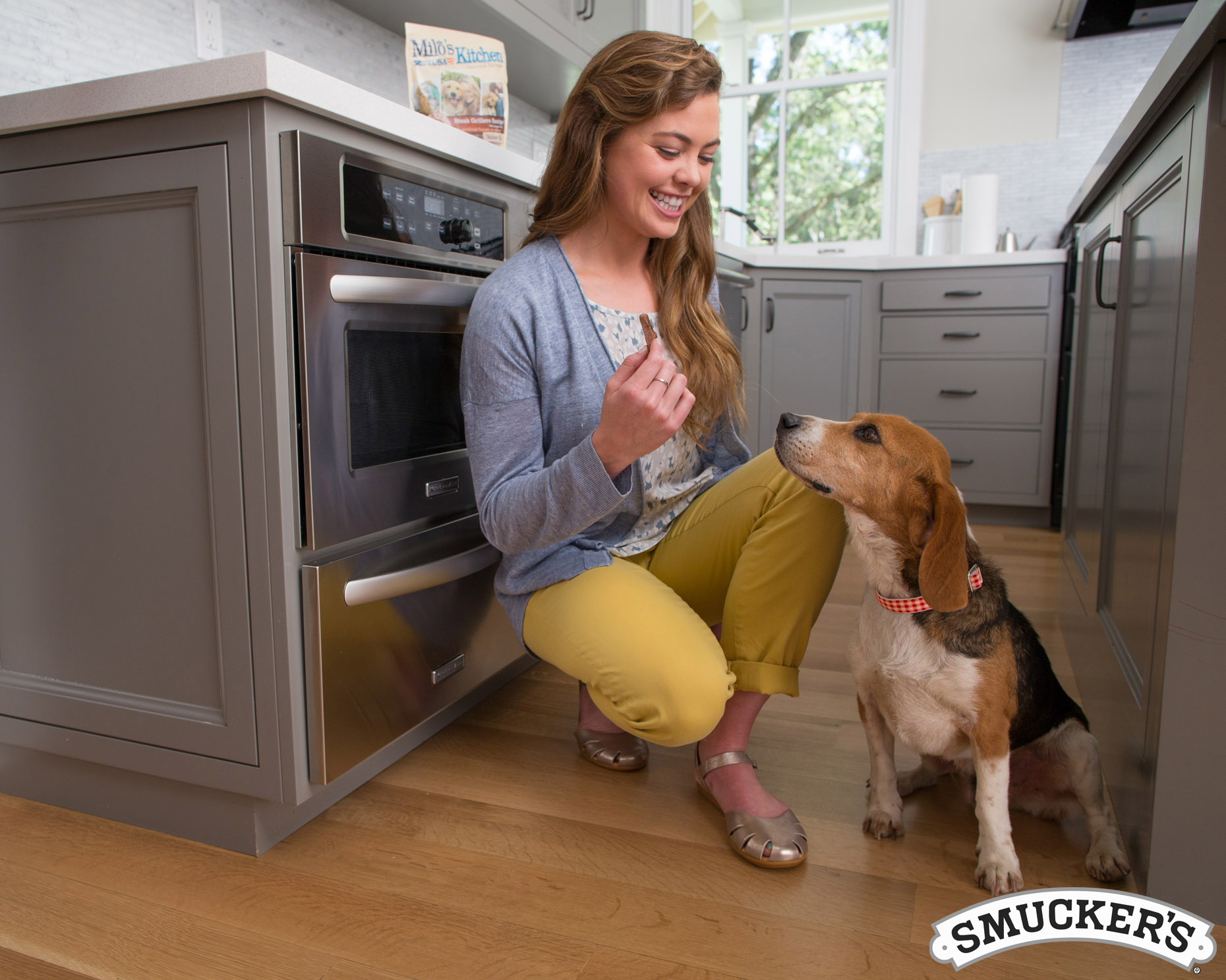 Advertising Photography | Woman Giving Dog Treat by Mark Rogers