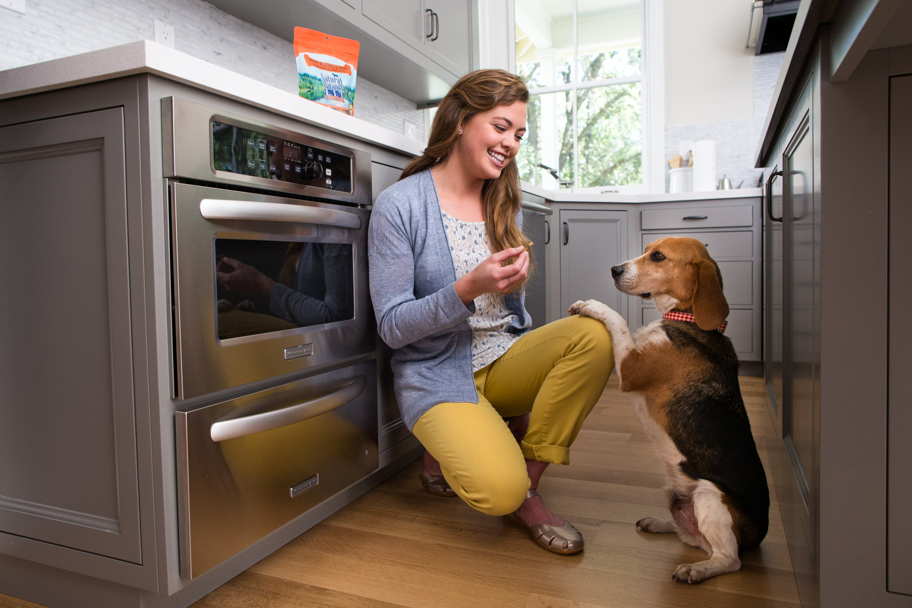 Pet and People Photography | Woman Giving Treat to Dog by Mark Rogers