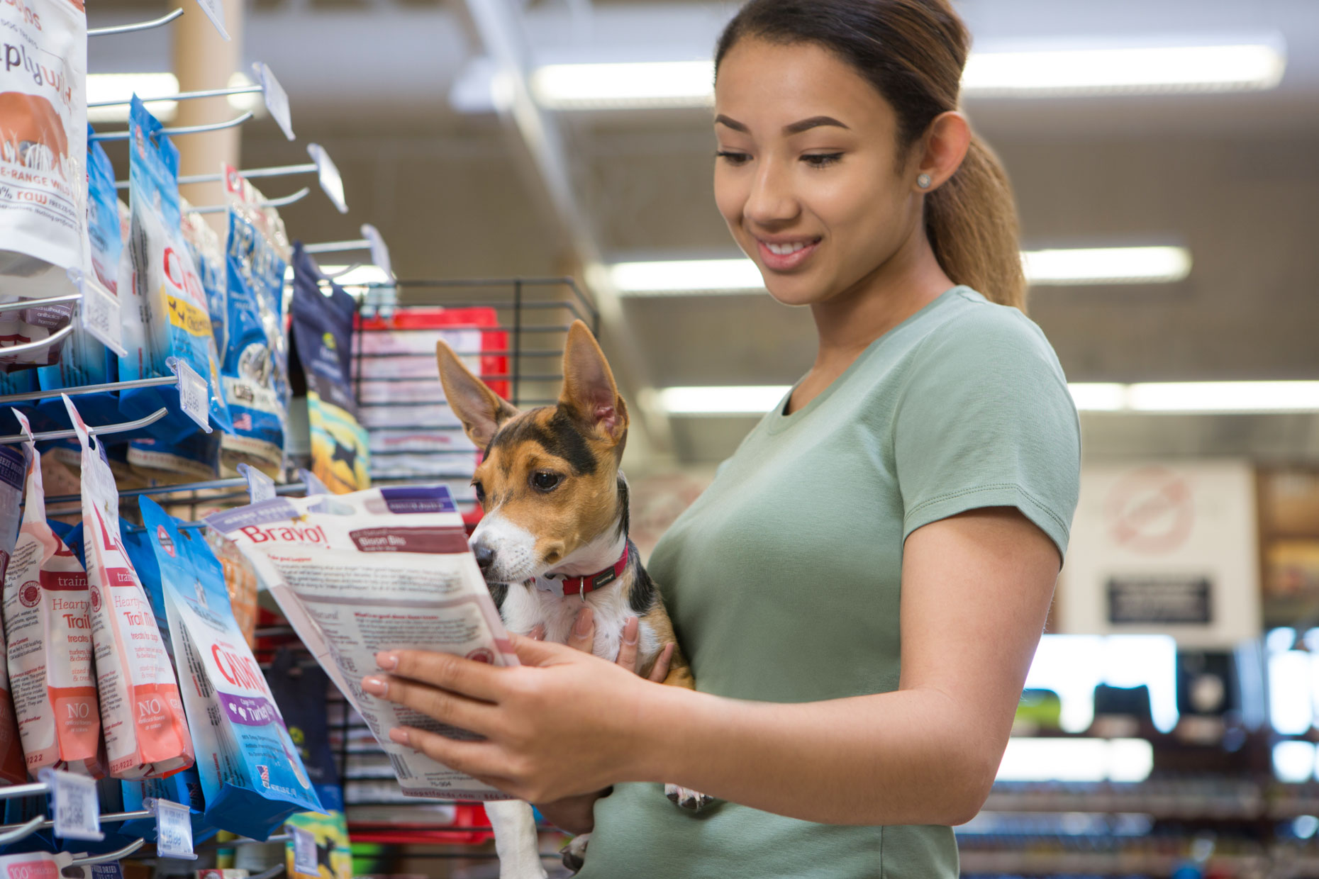 Pet Lifestyle Photography | Woman Shopping with Puppy by Mark Rogers